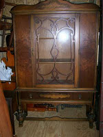 A brown wooden china cabinet